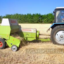 Заготовка пшеничной соломы из валков